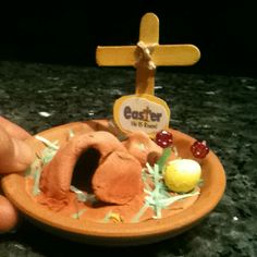 You can make a cute Easter Resurrection garden like this on a little dish with a little modeling clay and a craft stick. Easy and fun to ...