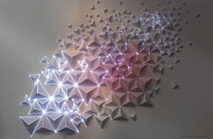 Paper, tape, light.Video projection onto origami.