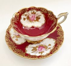 Vintage Royal Stafford china tea cup and saucer, made in England. This duo is stunning, pale pink roses are hand painted in cameos, lots of gold gilding on a raspberry ground. It is in good condition, no chips, cracks or crazing. Please Note: The items I sell are not new, they are