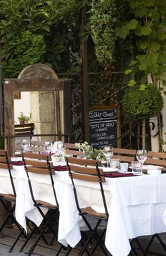 the mirror, cafe chairs, charming chalkboard, simple outdoor settings - via Inspired Design