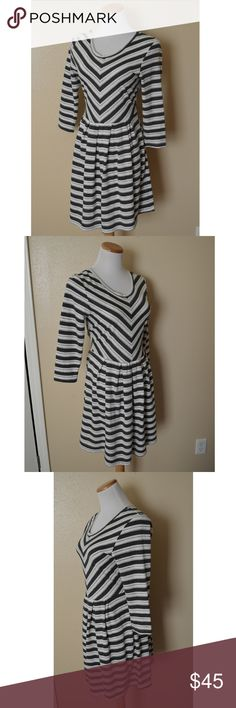 """Anthropologie Puella Mitered Stripe Dress Anthropologie Puella striped Mitered dress in size medium.  White with light gray and charcoal gray stripes.  3/4 sleeve.  Knit material.  Scoop neck. Excellent condition.  Measurements laying flat: Shoulders (top shoulder seam to top shoulder seam):15.25"""" Bust (armpit to armpit): 16.5"""" Waist: 15.5"""" Sleeve length (armpit to cuff): 12.5"""" Total length (top of shoulder to bottom hem): 32.25"""" Anthropologie Dresses"""
