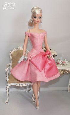 Silkstone Barbie doll   Outfit from Arina Fashions: Includes: dress w/ pink flower pin, coat, gloves, earrings & purse. It's fully lined. SOLD