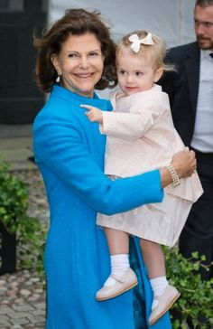 Queen Silvia's turns to hold her grand daughter Princess Estelle, during the dance celebration of King Carl Gustaf's 40th jubilee at the inner courtyard of the Royal Palace, 15 Sep 2013.