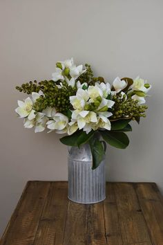 White Cymbidium Orchids, Green Magnolia leaves and Green Berries for $ 194 in our shop only! http://www.countryaccentfloralboutique.com/pages/artificial-flower-image-gallery #artificialflowers #homeideas #homedecor #homedecorating #decoration #decor #arrangement #weddingdecor #silkflowers #eventdecor #CountryAccent #floral #boutique #Australia