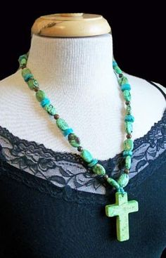 """Sagebrush Sirens: """"Margarita"""" Necklace by Two Crazy Arizonans-Bright lime and cool blue coroco are the elements of a fine margarita and the colors of this fun necklace.     Lime stones mingle with brown spheres, turquoise discs and finished with a brilliant green cross.     23"""" with lobster claw clasp.    Two Crazy Arizonans is hand made in Aguila Arizona. With genuine stones and unique designs, each piece is a one of a kind you will wear for years to come.     $36"""