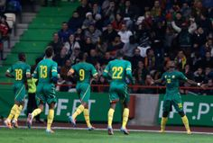 Cameroon's Vincent Aboubakar, right, celebrates after scoring his side's first goal during their friendly soccer match with Portugal Wednesday, March 5 2014, in Leiria, Portugal. The game is part of both teams' preparation for the World Cup in Brazil
