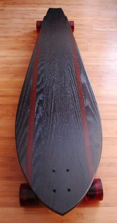 sweet longboard - I'm just guessing because of the material this would be a heavy board. More for cruising than doing flat tricks?