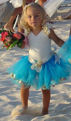This will be my lil Riley walking down the beach at the wedding!! : ) Her tutu will be the color of the bridesmaids dress.