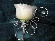 white rose boutonniere for wedding , event, and prom