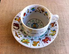 "Astrology, Fortune Telling, Tea Cup by ""International Collectors Guild.Ltd., Fine China,  Tasseography. 1985 on Etsy, $27.00"