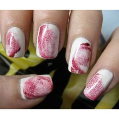 Fingerprint nail art-- Paint your nails white first. Then, you take red nail polish, paint or put some on your finger (not too much so it doesn't look nasty). Roll your finger across your nail (after the white dries of course). Done!!  :)