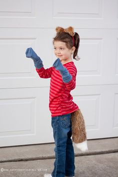 Fox in Socks, by Dr. Seuss. You need fox ears and tail, red shirt, blue socks.