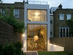 Amazing London terraced house - classic from the front with a modern surprise at the back - 6 meter high sliding glass windows