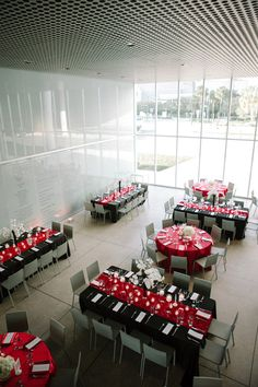 Reception with long and round tables: Tampa Museum of Art