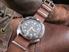 "NEW DC VINTAGE WATCHES AUCTION: Vintage 1985 Seiko 6309-7040 ""Turtle"" Automatic Diver, w/Leather NATO Strap---DC Vintage Watches is pleased to offer for bid a beautiful pre-loved vintage 1985 17-jewel Seiko 6309-7040 ""turtle"" automatic diver, presented with a sturdy leather NATO strap.  This Seiko also comes with its own free Pelican 1010 watch travel carry case."
