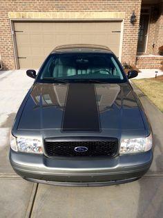My 2003 Ford Crown Victoria. 4.6L SOHC V-8, K&N CAI, Custom Duel Exhaust, Police Interceptor Grill, Mercury Marauder Style Rear Spoiler, Mustang Hood Stripe, Mustang Rocker Stripes.