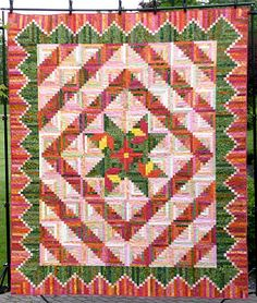 Thelma's favorite quilt she has finished: Hibiscus at My Caribbean Cabin. This is a combination of several patterns from Judy Martin's Log Cabin Quilt Book. Found on Cupcakes 'n Daisies blog.