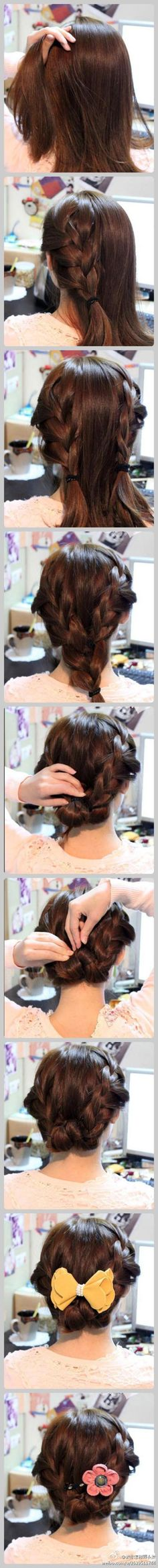 French braid up-do. My hair might be long enough for this. Like the hair color too