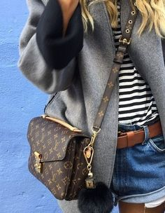 Mixing high-low pieces like a pro. | Louis Vuitton bag with cut off shorts and…