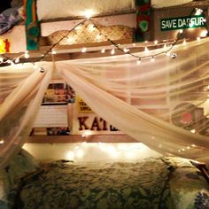 Dorm room DIY canopy I like the lofted bed, lights, pictures, and canopy for the underneath one...nice!
