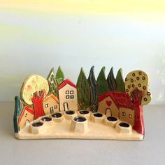 This is a unique one of a kind hand made and hand painted menorah. This ceramic menorah is a Hanukkah menorah and an Israeli Judaic clay menorah. This Israeli menorah represents the houses of lower Galilee, the area of Tiberias and the sea of Galilee, where I live and create! The small