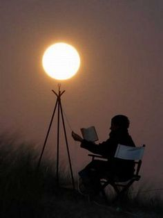 reading by the light of the moon.  if only. photographer laurent laveder