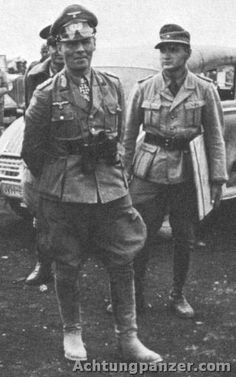 """Erwin Rommel in Africa. The German soldier holding the map was Rommel's executive assistant/personal interpreter, Wilfried """"Willy"""" Ambruster."""