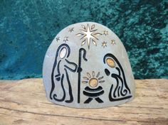 A hand engraved, unique, natural stone Nativity Set to begin or add to your collection. Celebrate every Christmas, Joyously with this Holy Family ensemble.  4 inches tall 4.5 inches wide 3 inches deep. This stone has a variation of colors, from gold to gray.  This listing is for ~1~ natural stone, engraved NATIVITY. It includes 1 glacier stone with -----Baby Jesus -----Joseph -----Mary  This river stone hales from the Snake River Valley in the Rocky Mountains of Idaho. It is just the right…