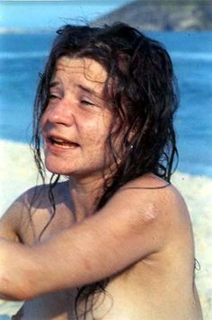 A topless Janis Joplin at the beach.