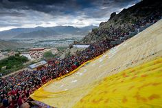 BRIGHT YELLOW: Buddhists and tourists participated in the 'sunning of the Buddha' ceremony, marking the start of the annual Shoton festival at Zhaibung (Drepung) Monastery in Lhasa, Tibet, Tuesday. The festival is one of the most important to Tibetans. (Purbu Zhaxi/Xinhua/Zuma Press)
