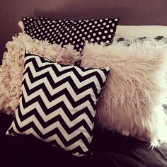 Lots of pillows covering the bed would be amazing. Greys, blacks, whites with a hot pink thrown in somewhere.