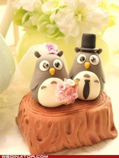 cute wedding topper...TOTOROS!!    I may have to force my brother to have these on his groom's cake one day.