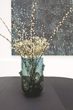 """The large vase """"Nipples"""" in front of a canvas of Marc Rebollo, glass creation Bohemian Eric Schmitt, conducted by Ajeto glassware Novy Bor, Czech Republic."""
