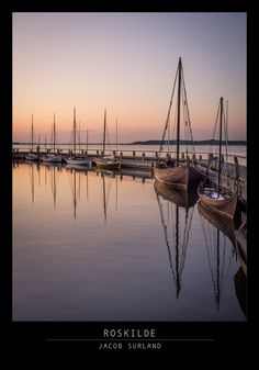 Viking ships on a row at sunset in Roskilde, Denmark. CC-NC.