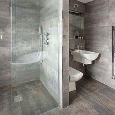 Dark grey tiled bathroom with walk-in shower