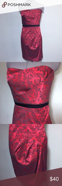 "NEW Red Black Brocade Strapless Cocktail Dress 7 S NEW With Tags! Tweeze Me Red & Black Brocade Strapless Cocktail Dress. Perfect for Holiday parties or Valentine's Day. Has a flattering fit with diagonal flat pleating and boning in the bodice. 50% less than buying from store! Juniors Size 7 measures flat approximately: 15"" across chest, 14"" across waist, 18"" across hips, 28"" long. Has back zip close. 51% cotton, 46% poly, 3% spandex, fully lined 100% poly. Dry Clean. Made in USA…"