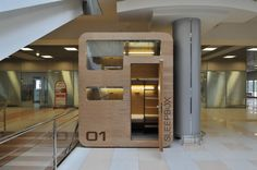 rent a sleep box in a Moscow airport. That would be weird,awkward ,and hard to change in a sleep box in an airport if you get what I'm hinting at Container Hotel, Sleep Box, Can't Sleep, Tiny House, Sleeping Pods, Diy Home Decor For Apartments, Capsule Hotel, Dezeen, Arquitetura