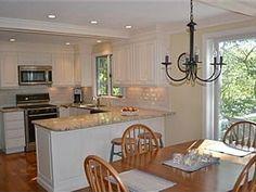 white u-shape kitchen with sliding door