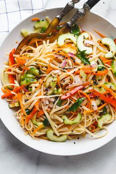 Asian Noodle Salad - With the Best Ever Ginger Vinaigrette. This vegan make-ahead salad is loaded up with healthy veggies and perfect for midweek lunches or larger gatherings.