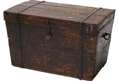 Antique wood trunk with original hand-wrought iron hardware. Original owner's name across front.