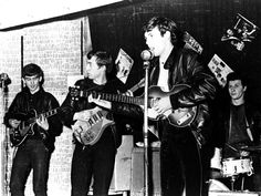 "In the Cavern Club before they were ""cleaned up"" by Brian Epstein."