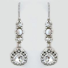 Haute Bride Earrings. Long drop earrings crystal earrings with a single pearl. Bridal earrings that complement just about any bridal style.
