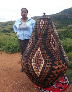This grand Ukhamba basket took about a year to weave. We go deep into the beautiful South African country side to collect baskets from our Zulu weavers.