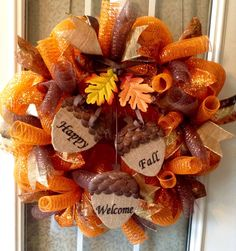 A personal favorite from my Etsy shop https://www.etsy.com/listing/458016922/24-fall-orange-deco-mesh-wreath-with
