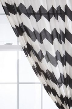 not as into chevron as everyone else is, but there is something striking about these black and white curtains!