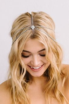 Available at the Bridal Boutique by MaeMe. 504.266.2771. lindsay hair- chain One of our absolute faves from this collection! This SWAROVSKI® rhinestone hairchain is a dainty headpiece that adds glimmers of sparkle throughout your hair. Varied rhinestone chain widths meet at the front and back connecting to a diamond shaped filigree detailed with rhinestones. Can be worn like pictured or moved more onto the forehead.  Rhinestones also available in champagne.