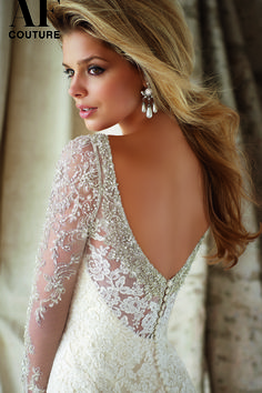 Angelina Faccenda Couture 1321 Wedding Dress - Floral lace drapes the entire trumpet silhouette of Mori Lee Angelina Faccenda Couture 1321 wedding dress, enhanced with shimmering beads sprinkled all over the bodice and along the sheer long sleeves. Luxurious beading highlights the sweetheart neckline, which digs lower over the semi-open back panel. Coated buttons draw attention to the sweep train that extends from the flared floor-length skirt.