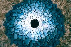 Pebbles Around a Hole ~ environmenal art by Andy Goldsworthy, 1987