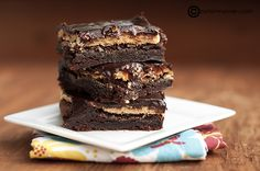 Buckeye Brownies...A chewy brownie, creamy peanut butter, and silky chocolate ganache create one decadent dessert!