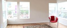 Abundant windows make the small living room feel spacious.  http://seattlebackyardcottage.blogspot.com/p/projects.htmlr